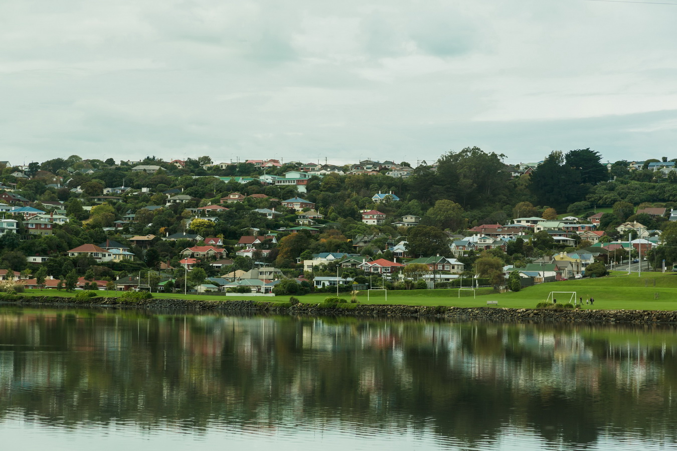 houses reflection in the sea,Dunedin, South Island ,New Zealand